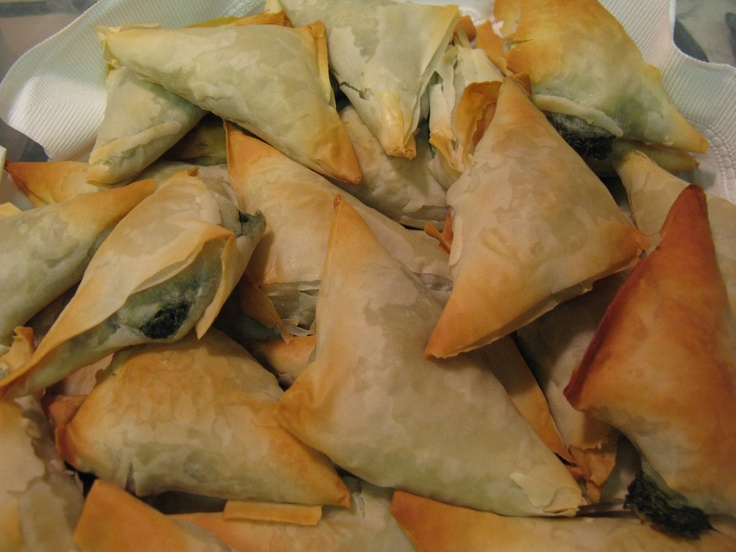 "My ""go to"" Spanakopita recipe comes from none other than Christine Cushing as published by Canadian Living.  Though I like to cheat and spray Butter Flavoured non-stick cooking spray between sheets of phyllo, instead of brushing with melted butter.  Saves a bit on the fat and calories... never had any complaints about the taste."
