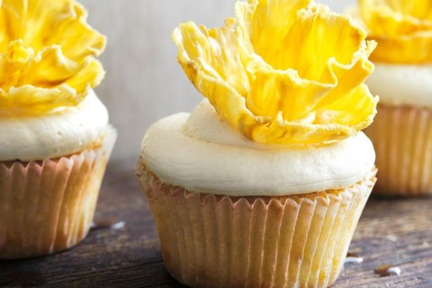 These fruity, flower-topped cupcakes will wow your guests with good looks and tropical coconut and pineapple flavours.