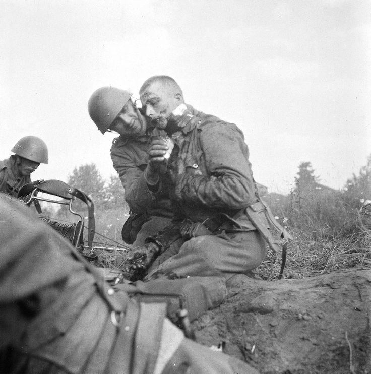 A Finnish soldier, whose artery was cut open by a grenade shrapnel. Kaalamo, Petäjävaara. 1941.07.22