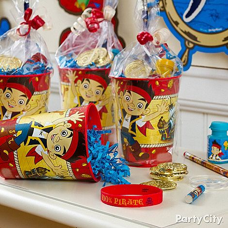 Send the pirate crew home with reusable cups filled with treasures! Add some paper shred, top with fun favors, then stick in a clear bag and tie off with ribbon - yay hey!
