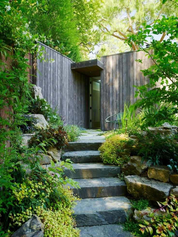 Front door could feel like this.  Cozy and intimate hugged up to the grade.  Garden entry feel  Mill Valley Cabins / Feldman Architecture