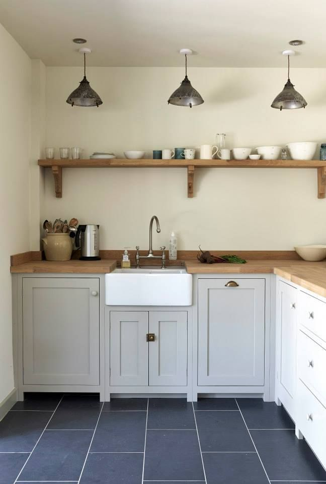 The Pembridge Border Oak Cottage features a Shaker Kitchen by deVOL a pretty kitchen in a beautiful country cottage. We love those pendant lights.