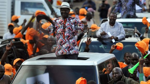 Raila Odinga, leader of the National Super Aliance (NASA), waves to supporters from a car in Nairobi, 25 October 2017