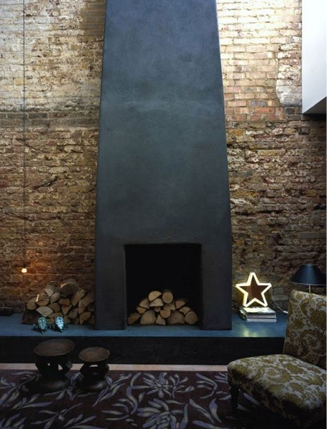 Above: A steel fireplace in London architect Jonathan Tuckey's own home (a converted stainless steel workshop).