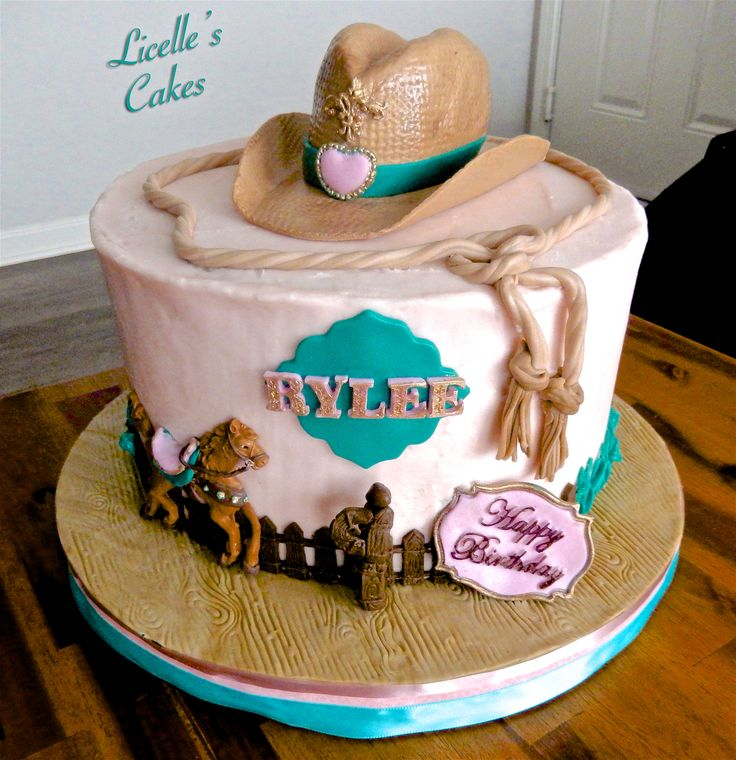 Cowgirl cake in Teal and Light Pink with Rice Crispies hat and fondant decorations