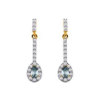 Ce bijou est une paire de boucles d'oreilles femme Clous avec Oxydes de zirconium synthétiques et Topaze Bleue synthétique en Plaqué Or Doré de la marque Altesse