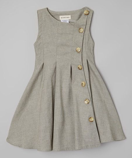 This dress' soft cotton blend features crisp, classic pleats and a row of buttons for easy dressing.