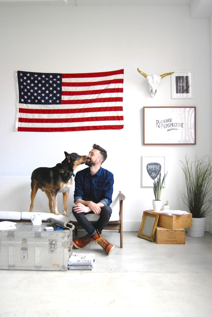 Name: Sean Michael Davis + Dog, Charlie Location: Ponce City Market in Old Fourth Ward — Atlanta, Georgia Size: 575 square foot studio Years lived in: 1 year With great natural light, clean lines, and a touch of creativity, this space is the envy of bachelor pads everywhere. Local Atlanta graphic designer, Sean Michael Davis, welcomes us into his home.