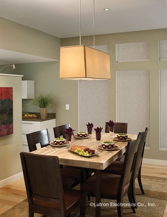 The neutral overhead light complimented by the natural hues of this kitchen provide a casual and