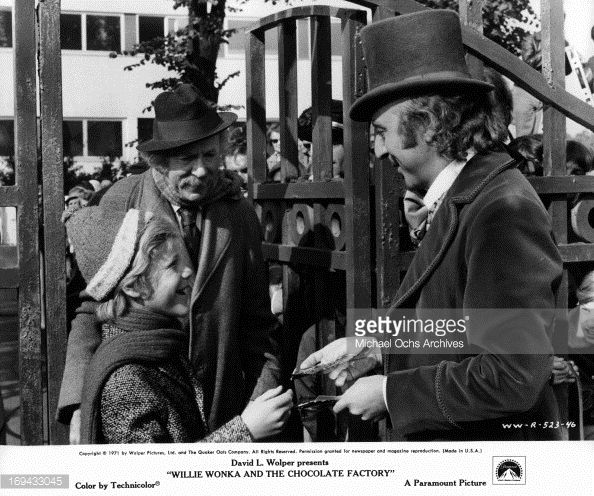 Peter Ostrum and Jack Albertson are greated at gate by Gene Wilder in a scene from the film 'Willy Wonka & the Chocolate Factory', 1971.