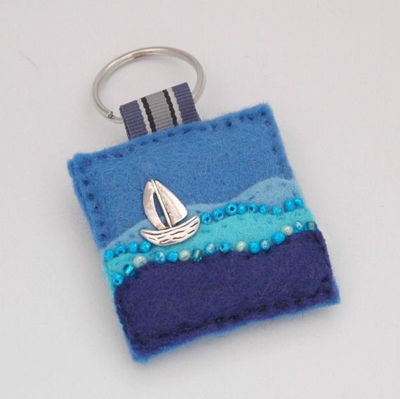 Hand sewn felt key ring featuring a detailed boat charm sailing on the water.     www.elliestreasures.co.uk
