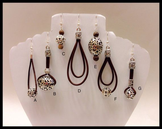 Beautiful Tibetan silver and Leather Earrings in Many Colors. These earrings measure 2 1/2 inches long and are made of led free materials . This is earring style G See link to complementing necklace https://www.etsy.com/listing/177097704/chocolate-leather-necklace-color?ref=sr_gallery_65&ga_search_type=all&ga_view_type=gallery