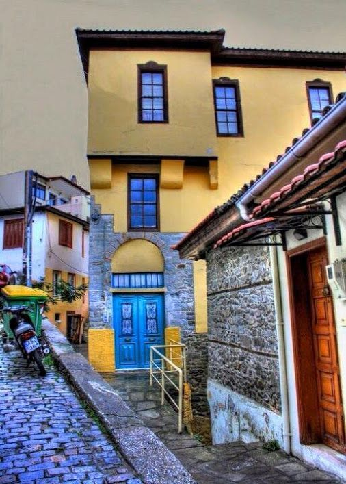 Kavala, Macedonia, Greece buildings blue doors bricks streets grey brown sky: