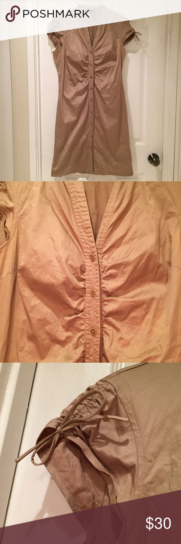 Club Monaco Button Down Khaki Shirt Dress In excellent used condition from Club Monaco. It is a khaki beige colored button down shirt style dress with the ruched short sleeves. Very light fabric wear and no holes or stains. The fabric has a little stretch to it.   Reasonable offers welcome and I do not trade. 15% discount on bundles of 2 items Club Monaco Dresses Midi