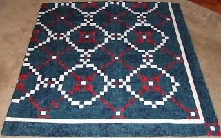 I've always loved this pattern: Burgoyne Surrounded . . . Nice colors in this quilt.