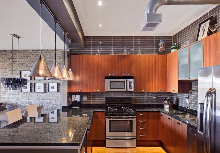 A contemporary and sophisticated #kitchen design with the perfect #granite and stacked black glass tile #backsplash!