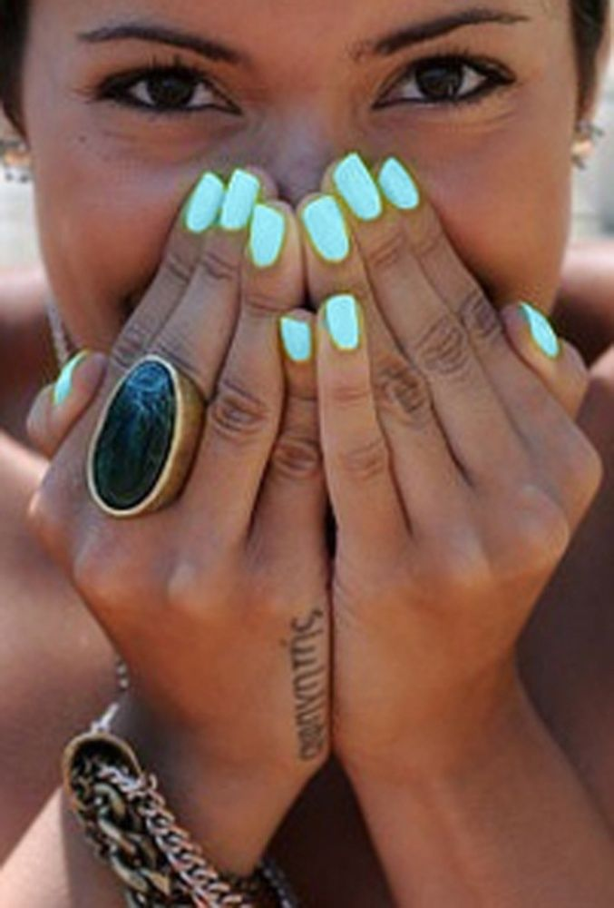 I love the color! But especially I love her tatoo. I don't know what it says but I love the font!