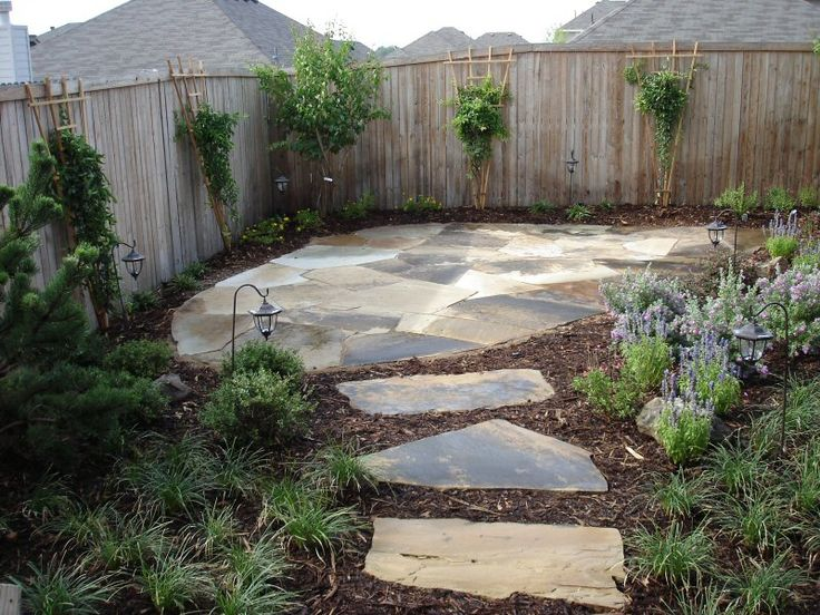 Here a secondary outdoor living area has been created in yard corner via the flagstone path off the main Patio area.
