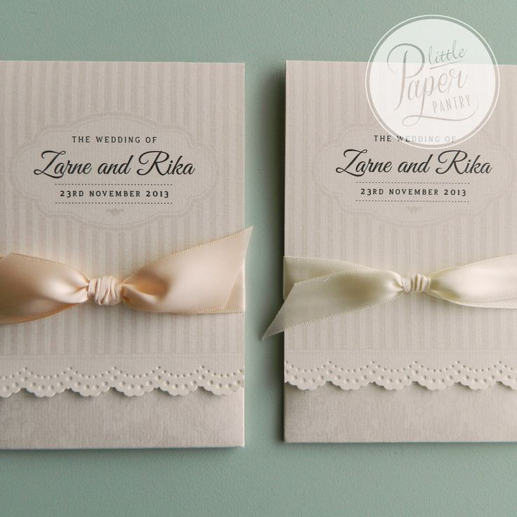 lace punched invite with a lace & stripe pattern, finished with a satin bow.