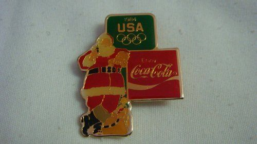 1984 Coca Cola Christmas Olympic Pin by Oohlala Company. $12.99. 1984 Coca Cola Christmas Olympic pin. This pin, along with other dated Coca Cola Christmas Olympic pins were made to sell around the 1984 Olympics. Rare to find! Made by the Oohlala Company who were licensed to manufacture and distribute by Coca Cola.