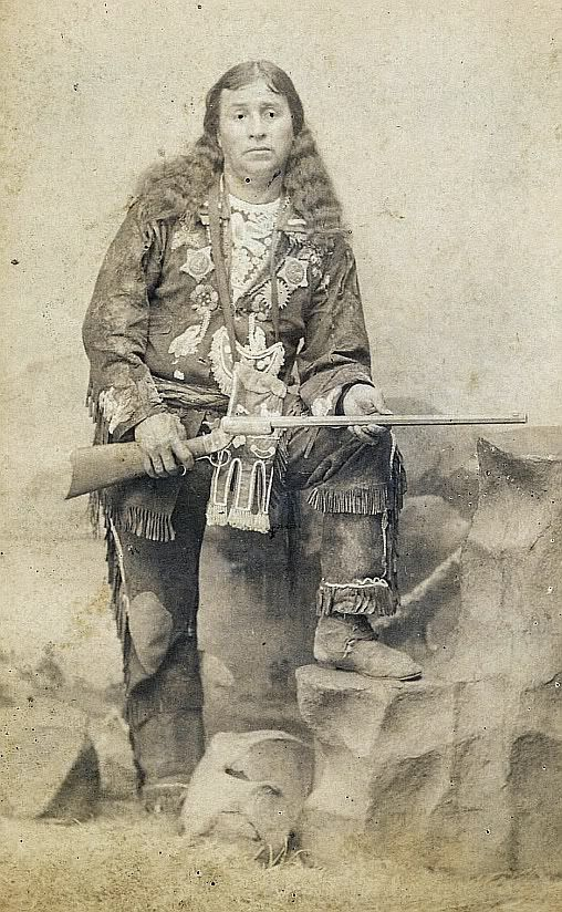 "Cabinet Card Photograph of ""Mountain Panther"" Warm Spring Indian Chief ca 1890s - This Warm Springs Indian is holding a Stevens octagon barrel rifle, dressed in his elaborate costume, with pipe bag & fringed outfit. The photograph was taken in G. V. Fry studio of Bucyrus, Ohio. Some one has in high-lighted his eye pupils."