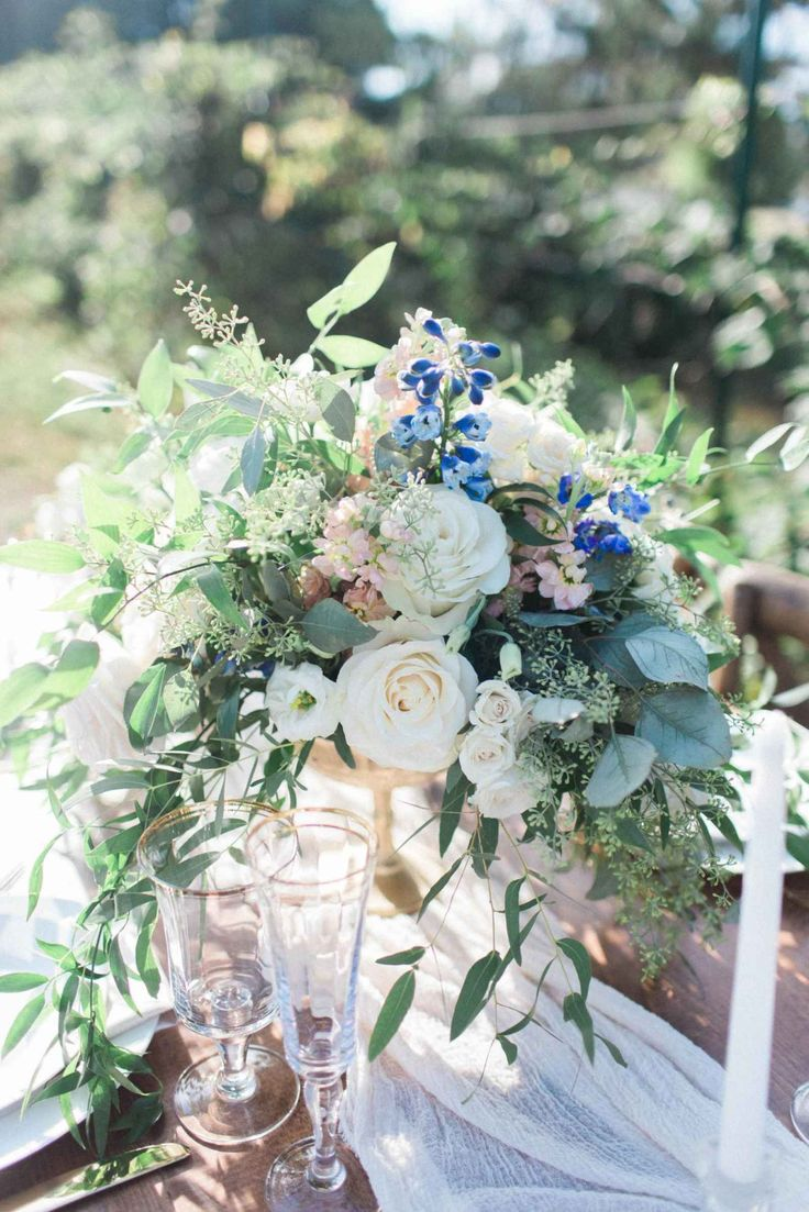 A gorgeous white and blue summer bouquet! Vineyard inspired wedding bouquet/ airy wedding theme/ summer wedding florals/ white roses for wedding flowers | WeddingDay Magazine