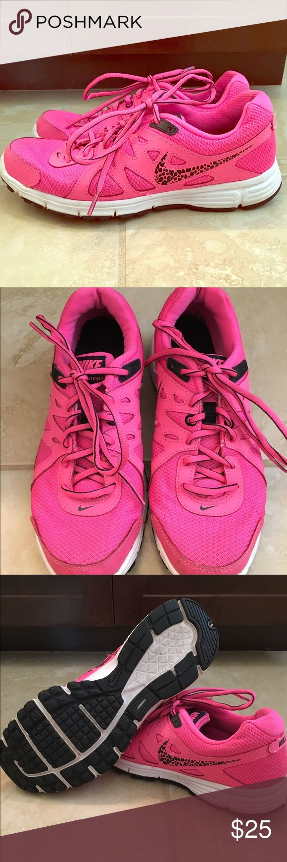 """Bright pink Nike running shoe Pink Nike revolution running shoe size 9 with """"leopard"""" like swish. Super comfy cute and gently worn. Excellent condition!  Nike Shoes"""