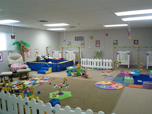 "Infant room! I love it all! The little ""circle time"" spots, the padded play area, the gated off swing..."