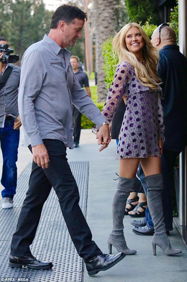 She's glowing! Christina El Moussa looked happy to step out with new boyfriend Doug on Friday, where she strutted her stuff in a leggy purple frock