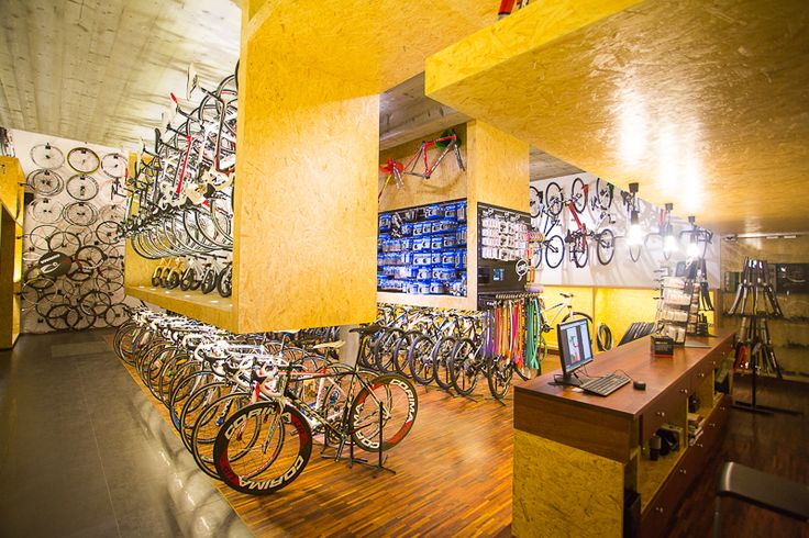 Cycling store in Poland. #bikeidshop #bikes #osb #lapierre #look #knog #blinder #counter #concrete #interior #bicycle #store #archotecture #poland #cracow