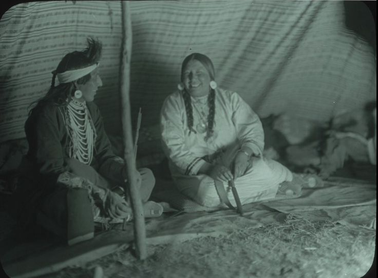 Crow Couple in Tipi. Indian reservations--Montana. Collection Richard Throssel. Date Original: 1902-1933.  University of Wyoming. American Heritage Center.