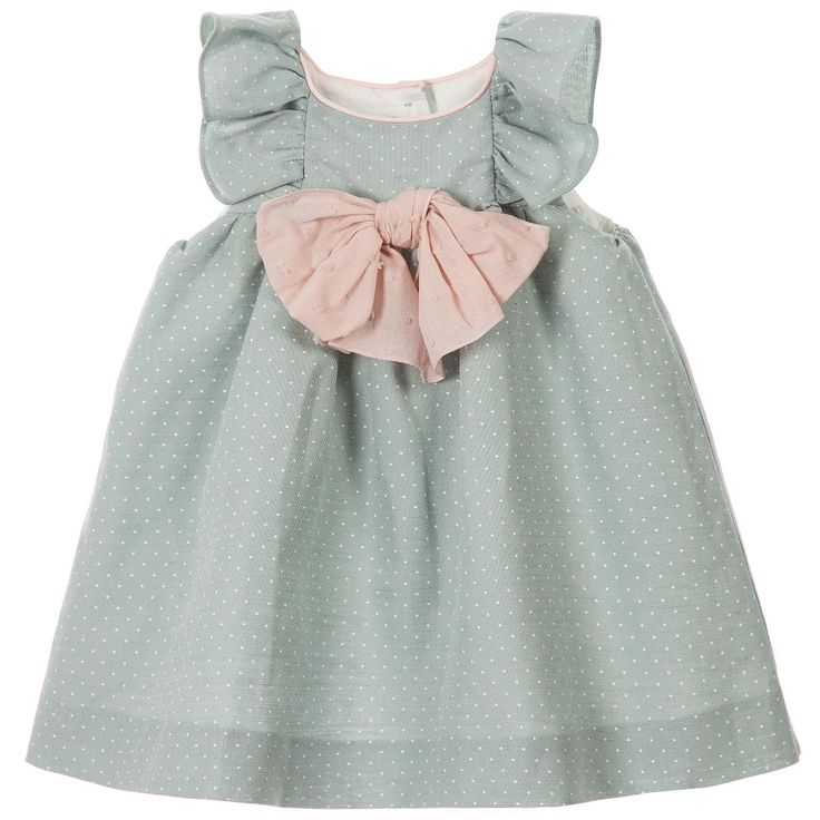 Baby girls pastel green Nanos dress with a white polka dot print and short ruffled sleeves. Made in a softly textured linen mix, it has a soft cotton poplin lining and comes with frilly knickers. There are buttons on the back to fasten and a sweet pink bow on the front with pink piping to finish. Perfect for both smart and casual occasions, it will would look adorable with little sandals.