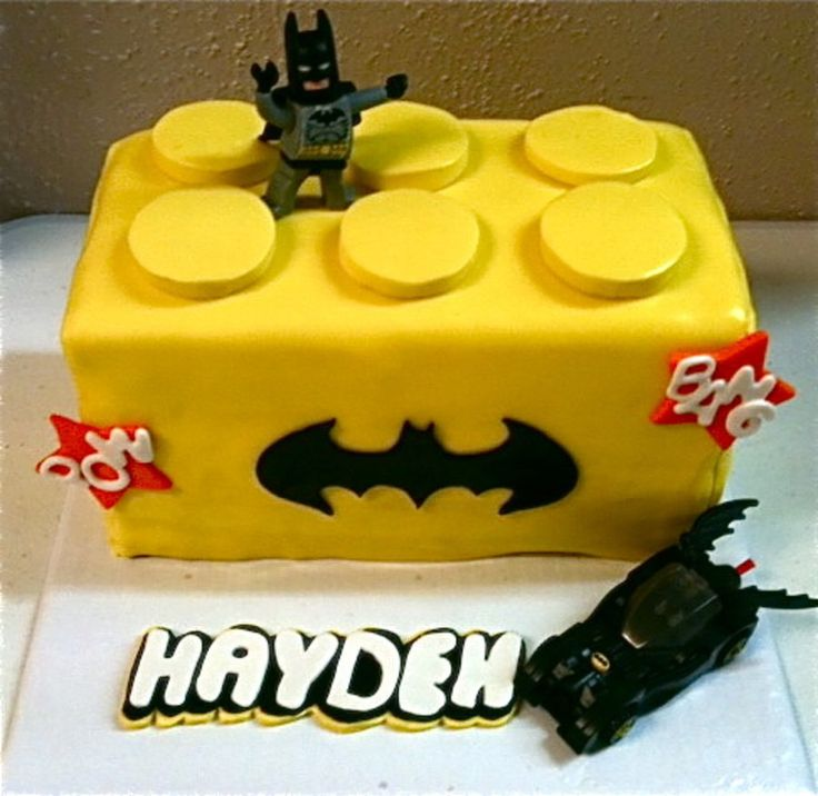 Lego Batman Cake Vanilla cake with Chocolate Mousse fillingAll edible except Batman and his carName in Lego logo