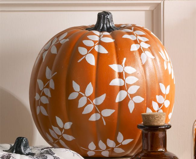 Use stencils and craft paint to diy this elegant pumpkin