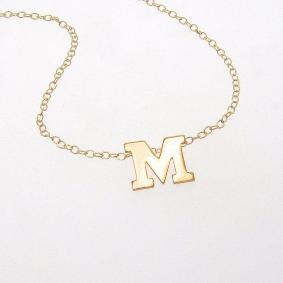 Initial Necklace - Gold letter of your choice.  This is a subtly sexy necklace. Why? Because the small, shiny 14K solid gold Initial rests right around the hollow of the neck...a very sexy part of a womans anatomy. A (handsome) man cant help noticing it, and wondering your name...?!  I attached a very thin, delicate 14k gold filled chain behind this 14K SOLID GOLD 8mm Initial so that all one really notices is the shiny Initial. What makes my Initial so special and different from the rest, is…