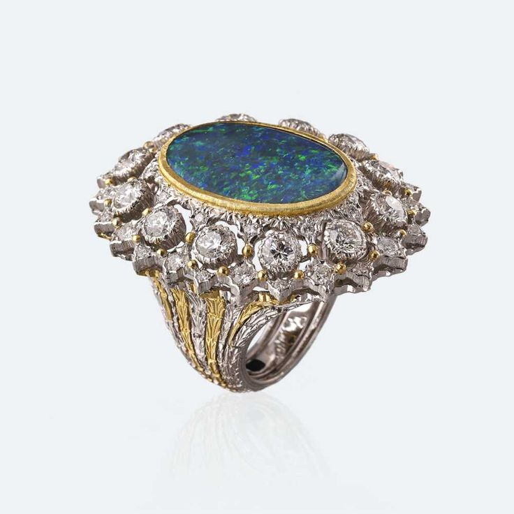 The colors of the central cabochon opal recall the tones of our Mediterranean sea, so full of gree and blue, more or less intense. The diamonds contouring the central stone are the foam of the waves when they break on the seashore and leave the sea colors behind them. Http://www.facebook.com/diamonddreamfinejewelers http://www.twitter.com/diamond_dream_ http://www.instagram.com/diamonddreamjewelers