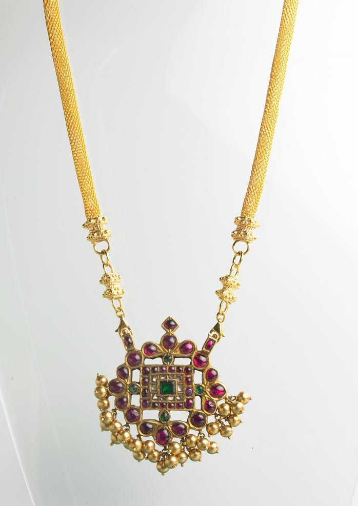 ruby pendant traditional south indian style,on a gold chord