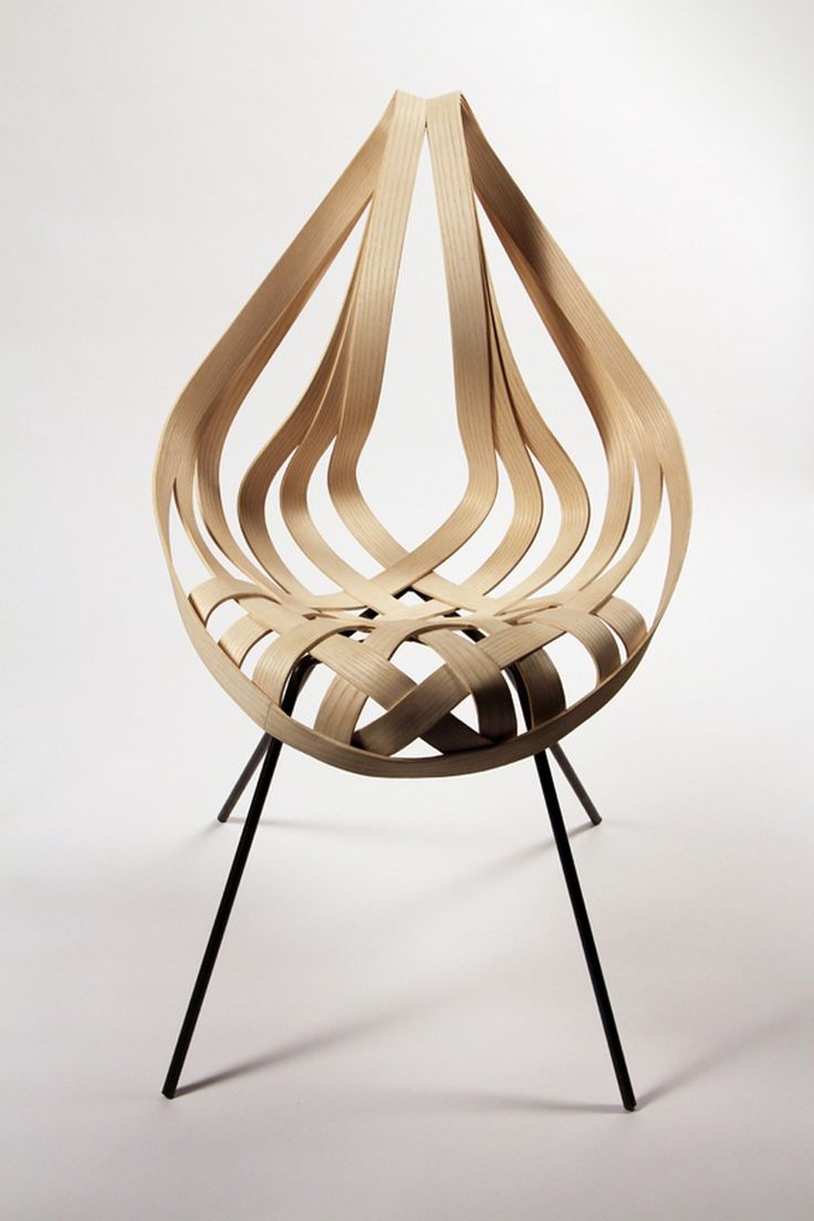 Saji Chair is a wavy wooden chair designed byLaura Kishimoto The Saji chair began as a personal challenge to myself to create a three dimensional form fro
