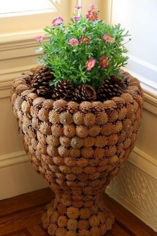 """Flowers and other articles made of pine cones! """" Women's World"""