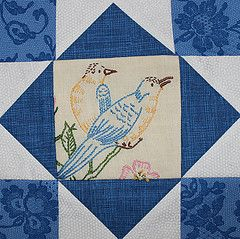 She used a piece of vintage embroidered linen for the centerpiece of this quilt block.