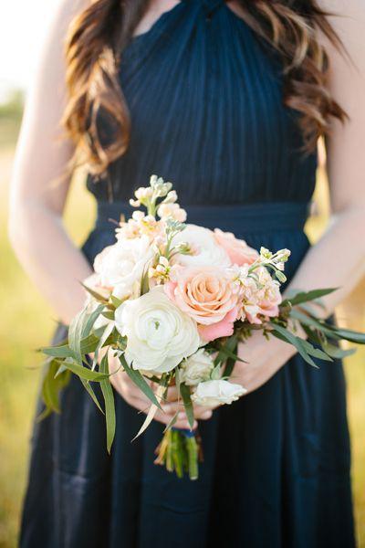 navy dress + peach bouquet | Tucker Images