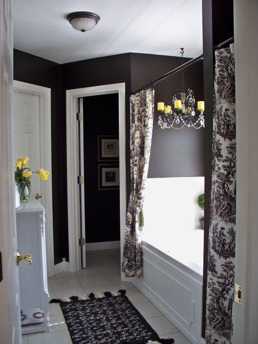 love the dark wall color in contrast to the white bathroom toile shower curtain
