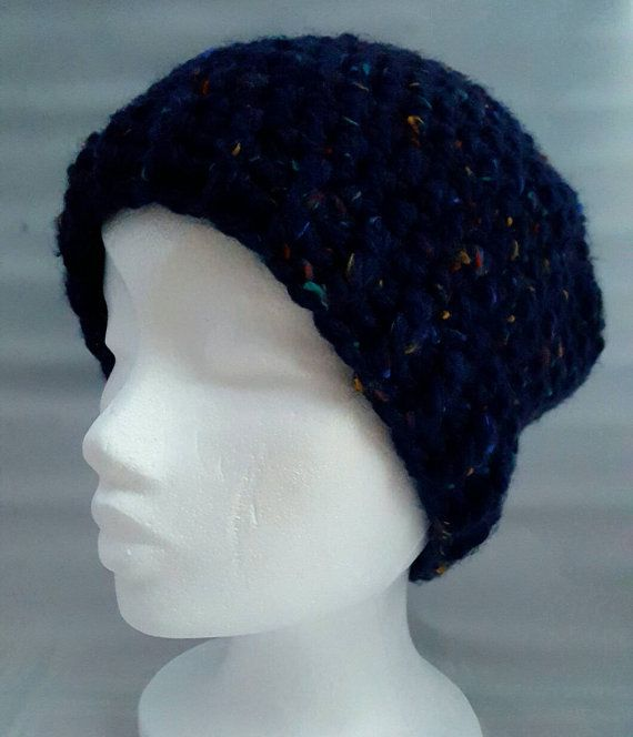 This is a hand crocheted was winter hat. Size suitable for a medium to large head.  A perfect gift for anyone in your life, or why not treat yourself! The simple design means it this hat is suitable for a woman or man.  Made from blue chunky yarn with flecks of red, green and yellow yarn as shown in the fifth photo. This hat is great for the cold weather and easy to clean on a 30° cycle in the washing machine.  This is a ready made item. Please check with my policies to ensure you agree with…