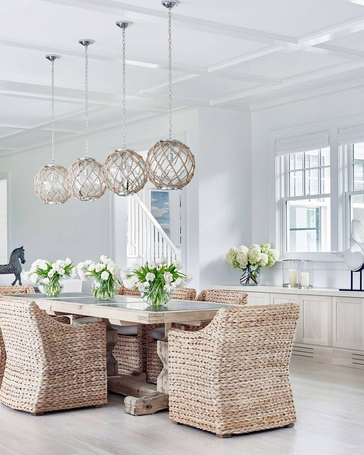 Neutral #interiors look even better with a hint of #coastal. I'm loving everything about this #Hamptons #BeachHouse with bleached #hardwoodfloors, #rope and glass #globe #pendants and #woven #abaca #diningchairs. Design is by @changoandco #followers #interiors #InteriorDesignIdeas #interior #interioroftheday #pictureoftheday #lighting #chairs #homeideas #homedecoration #homedecor #Houzz