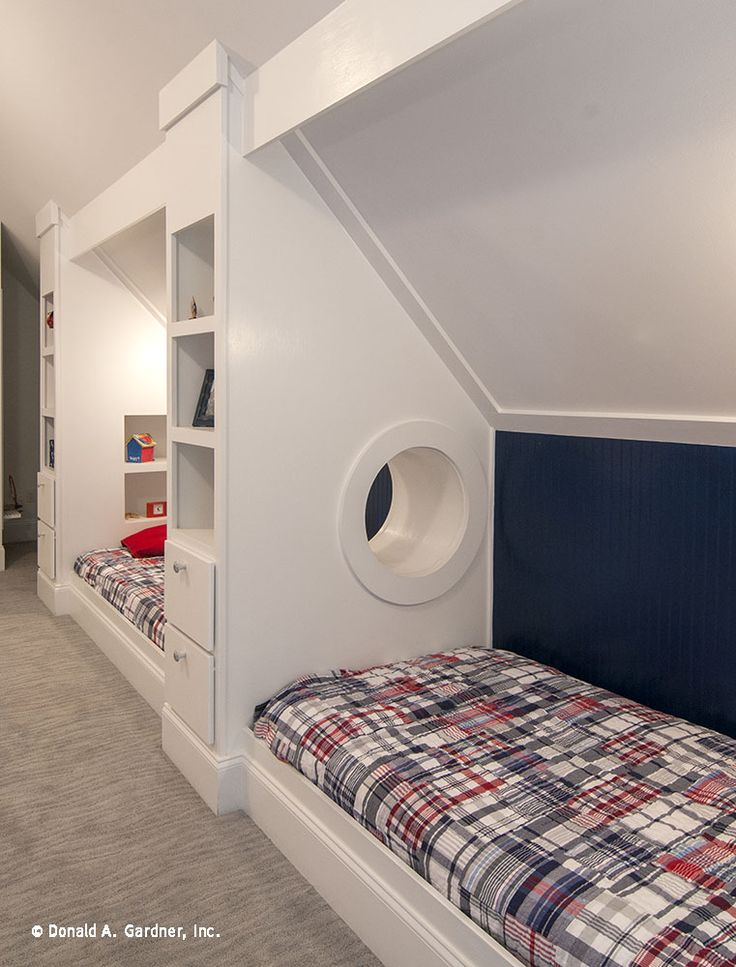 Additional kid's beds in the bonus room feature built-in shelves and drawers. But the show-stopper is this porthole that children (and adults) are sure to love! http://www.dongardner.com/plan_details.aspx?pid=4229. #BonusRoom #Children #Design