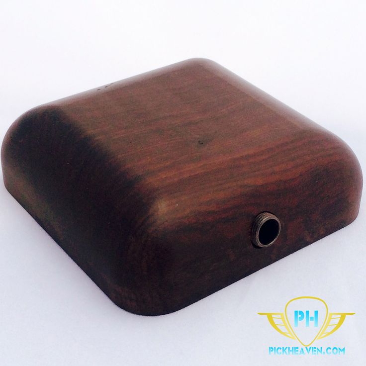 """Our Stomp Box prototype is a one off design made from solid ebony. It is small enough to fit in your back pocket or easily into your gig bag. Its acoustic qualities are amplified by a simple, piezo pickup that is connected to a 1/4"""" jack. The Stomp Box is a blast when it is paired with reverb and echo, or even some overdrive. We won't be making another like this, so don't miss out on a chance to add this unique piece to your collection!"""
