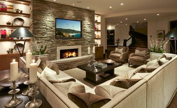 Fireplace & TV on stone wall in Family room