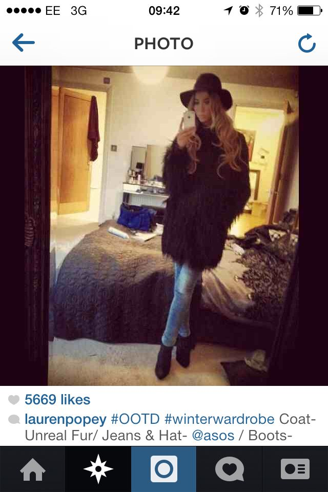 Lauren pope here wearing asos un-real fur coat, hat & jeans. Marks & Spencer's boots. I admire this women's recent popularity with fashion