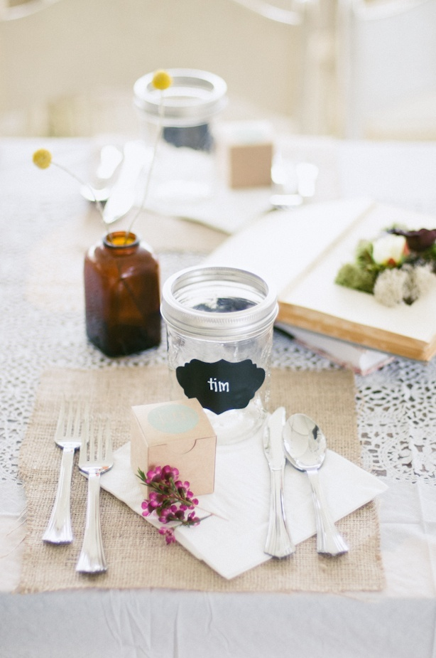 Simple place setting of burlap place mats and mason jars.  Photo by Honey Honey Photography.  www.wedsociety.com  #wedding #placesetting ... Wedding reception dinner table placesettings ... Rustic glamorous, vintage glamor, country elegance, shabby chic, whimsical, boho, best day ever
