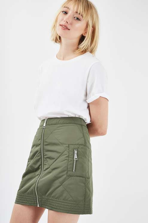 The tomboy-girl's staple skirt, this khaki style comes in a cool wadded bomber style fabric with a zip detail through the middle. In a mini cut, keep it casual with a plain white tee and ankle boots. #Topshop